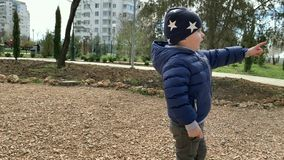 Cute beautiful child. Cute beautiful baby boy 3 years on the playground having fun. Sincere emotions stock footage