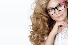 Cute, beautiful blonde young girl with amazing hair and glasses . Beauty,. Elegant and joyful girl Stock Image