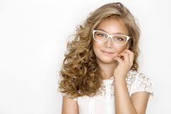 Cute, beautiful blonde young girl with amazing hair and glasses . Beauty,. Elegant and joyful girl Royalty Free Stock Image