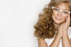 Cute, beautiful blonde young girl with amazing hair and glasses . Beauty,. Elegant and joyful girl Royalty Free Stock Photography
