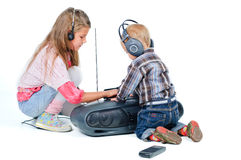 Cute beautiful brother and sister listen to music Stock Photos