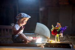 Free Cute Beautiful Child, Blond Kid, Reading Book And Playing With Construction Blocks In A Cozy Attic Room Royalty Free Stock Photos - 188794998