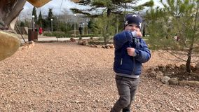 Cute beautiful child. Cute beautiful baby boy 3 years on the playground having fun. Sincere emotions stock video footage