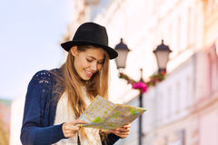 Cute beautiful girl with hat holding city map Stock Images