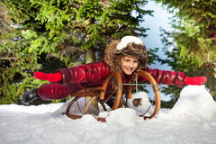 Cute beautiful girl having fun on snow sledge Royalty Free Stock Photo
