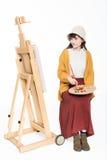 Cute beautiful girl painter Stock Image