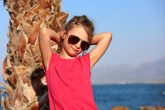 Cute beautiful kid girl in fashion sunglasses standing and relax Stock Images