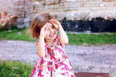 Cute beautiful little girl hides her face in her hands. Beautiful little girl hides her face in her hands Stock Images