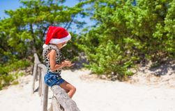 Cute beautiful little girl in Santa hat during Royalty Free Stock Photo