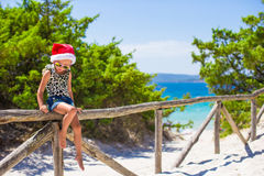 Cute beautiful little girl in Santa hat during Royalty Free Stock Photos