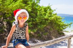 Cute beautiful little girl in Santa hat during Royalty Free Stock Images