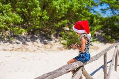 Cute beautiful little girl in Santa hat during Stock Photography