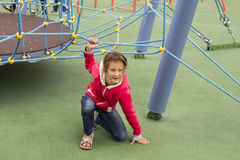 Cute beautiful smiling little girl on a playground. Portret Stock Image