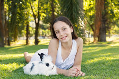 Cute beautiful smiling teen girl with white and black baby rabbi Stock Photos