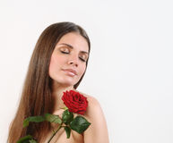 Cute beautiful woman with red rose on white background. Pure skin and strong healthy bright hair. Spa beauty concept Stock Photos