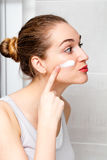 Cute beautiful young woman for fun morning routine in bathroom Stock Photography