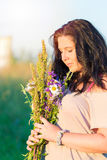 Cute beautiful young woman portrait with field flowers during summer sunset. Cute beautiful young woman portrait with field flowers during summer sunset Royalty Free Stock Image