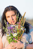 Cute beautiful young woman portrait with field flowers during summer sunset. Cute beautiful young woman portrait with field flowers during summer sunset Royalty Free Stock Photo