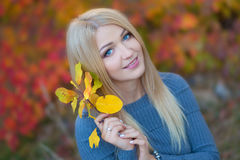 Cute beautifull girl lady woman with blond hair in stylish dress with hat standing in autumn forest. stock images