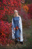 Cute beautifull girl lady woman with blond hair in stylish dress with hat standing in autumn forest. stock image