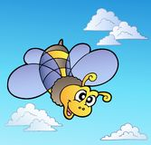Cute bee on blue sky Royalty Free Stock Photo