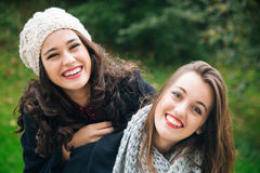Cute best friend girls a piggyback Royalty Free Stock Photos