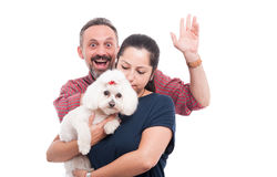 Cute bichon dog and his owners Stock Photos
