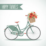 Cute bicycle with basket full of flowers Stock Image