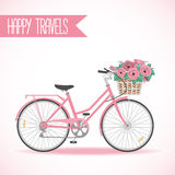 Cute bicycle with basket full of flowers Stock Photo