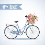 Cute bicycle with basket full of flowers Royalty Free Stock Photo