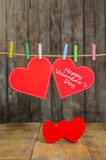 Cute big red heart hanging on the clothesline. Stock Images