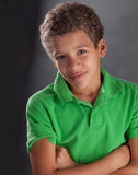 Cute Biracial Preteen Boy. A portrait of a curly haired preteen boy with crossed arms Stock Images