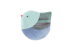 Cute bird sew by cloth Stock Photos
