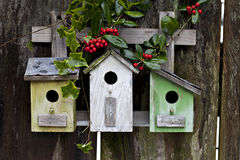Cute birdhouses on wood fence Royalty Free Stock Images