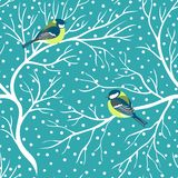 Cute birds titmouse parus on snowy trees seamless pattern