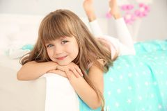 Cute birthday girl lying on bed. At home royalty free stock images
