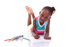 Cute black african american little girl drawing - African people Stock Images