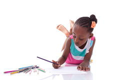 Cute black african american little girl drawing - African people Royalty Free Stock Photography