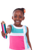 Cute black african american little girl holding color pencil - A Royalty Free Stock Image