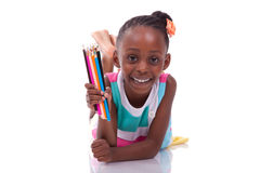 Cute black african american little girl holding color pencil - A Royalty Free Stock Images