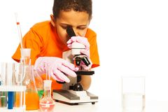 Cute black boy looking into microscope Royalty Free Stock Images