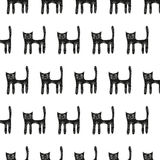 Cute black cat seamless pattern on a white background Stock Image