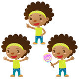 Cute black girl. Showing,pointing and holding a lollipop Royalty Free Stock Photo