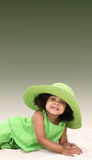 Cute black girl with green hat Royalty Free Stock Photography