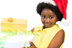 Cute black girl holding christmas gifts. royalty free stock image