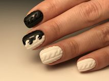 Cute black and white nails with design royalty free stock image