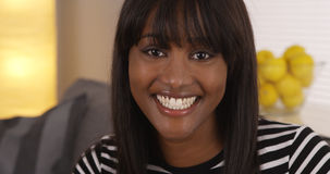 Cute black woman smiling in striped shirt Stock Image
