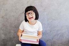 Cute blackhair little girl with books Royalty Free Stock Image