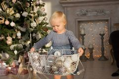 Free Cute Blond Baby Girl Exploring Christmas Tree, Presents And Toys On The Beautiful Sunny Christmas Morning Royalty Free Stock Image - 164824856