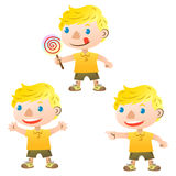 Cute blond boy. Pointing and holding lollipop Stock Photo